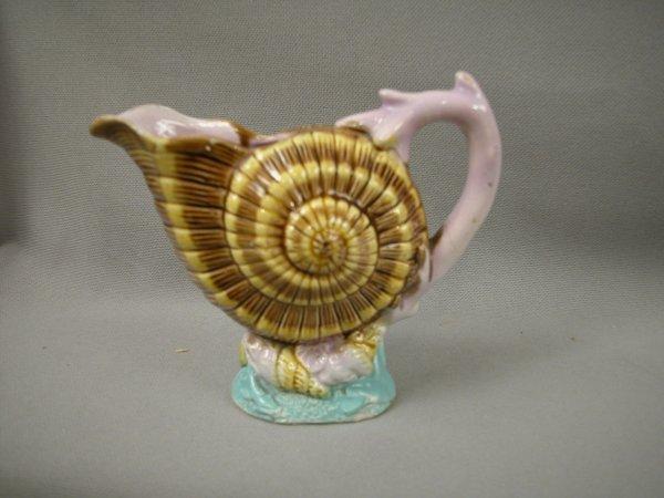 418: Majolica English shell creamer with coral handle,