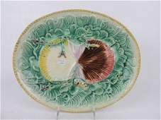 Majolica shells on waves platter,