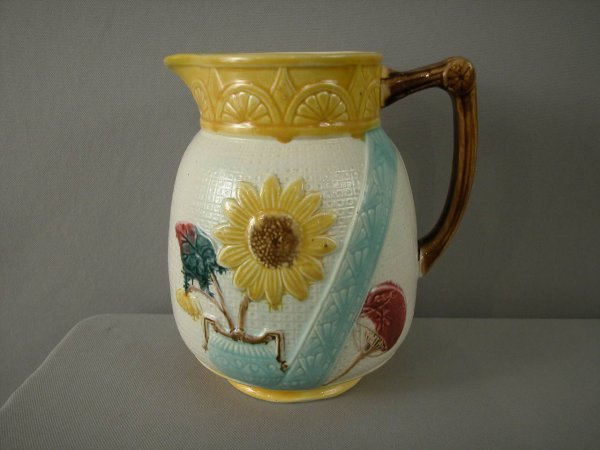 "223: Majolica  SAMUEL LEAR sunflower and urn 8"" pitcher"