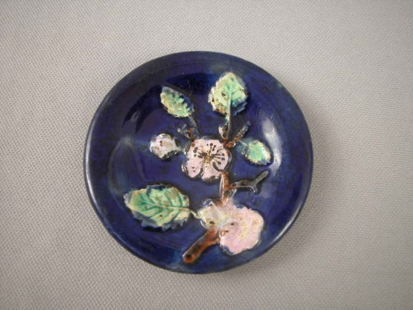 508: Majolica  Cobalt butter pat with branch, flowers a