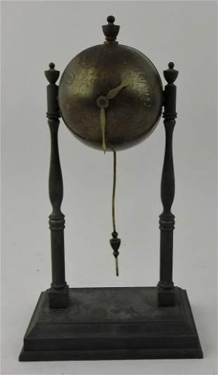 "Small globe wind up clock, 10"""