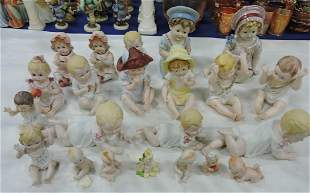 Lot of 27 bisque piano babies and kewpies