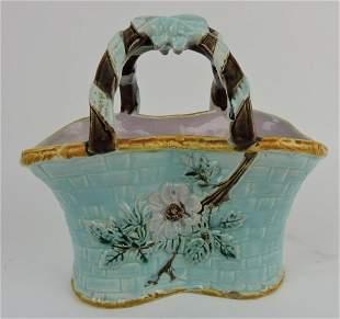 Majolica basket with ribbon tied handle,