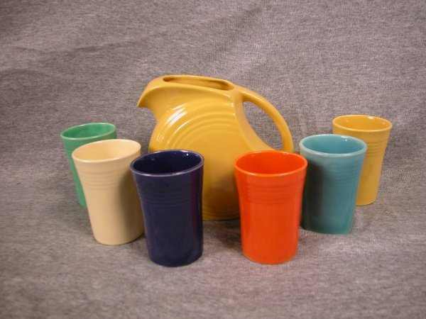 423: Fiesta juice set with yellow disk juice pitcher an