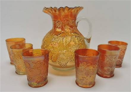 Marigold carnival glass grape pitcher and