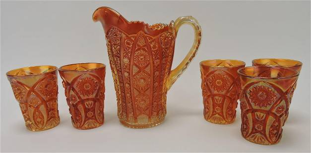 Marigold carnival glass pitcher and 5
