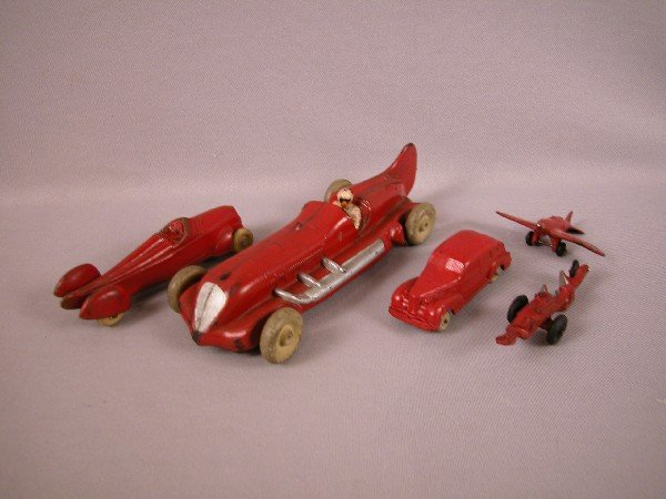 1: Lot of 5 hard rubber toys - Auburn racer, sedan, air
