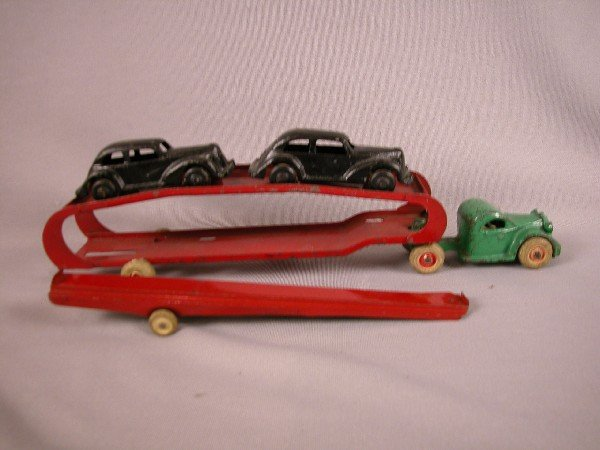 4: Arcade cast iron car hauler with two cars and ramp,
