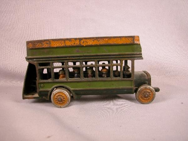 7: Cast iron double decker bus with passengers, loss of