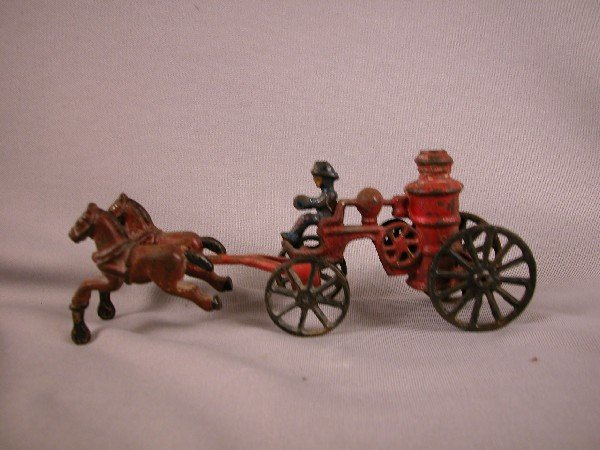 10: Cast iron horse drawn fire engine, some paint loss,