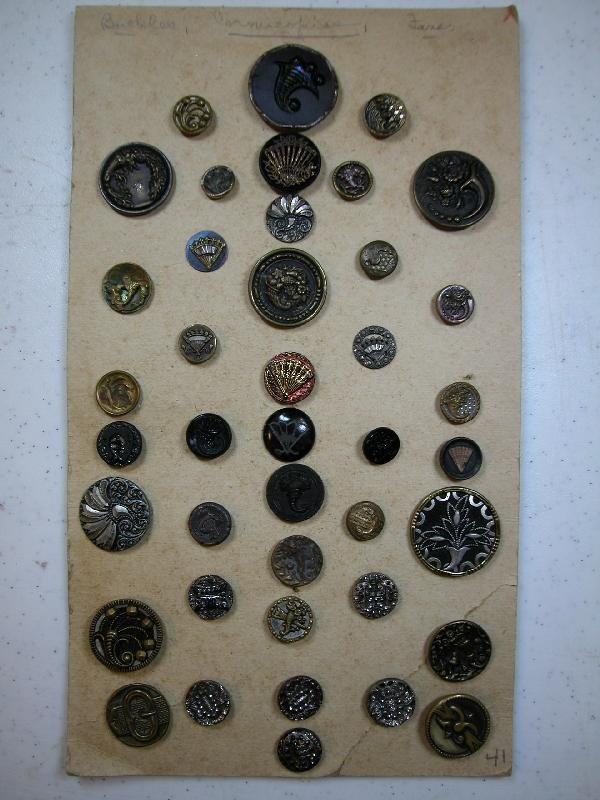 4003: Card of 41 buttons with conucopia, fan and buckle