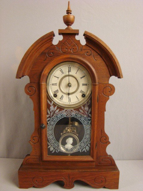 6: Ansonia walnut kitchen clock with cameo pendulum, 21