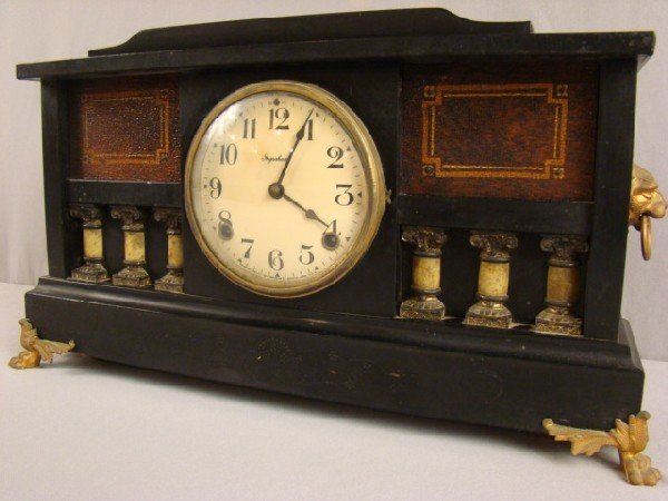8: Ingraham black mantle clock with lion head handles
