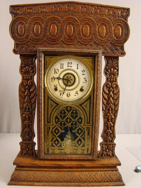 "13: Oak gingerbread kitchen clock, 23""h, nice carving"