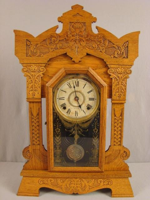 14: Seth Thomas oak kitchen clock with nice carving, 25