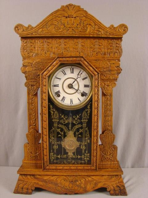 "15: Gilbert ""Steamer No. 4"" oak kitchen clock, 25"" carv"