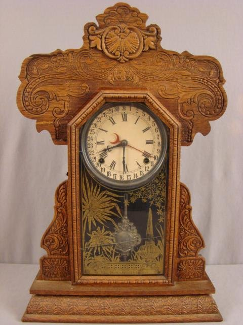 "16: Ingraham ""Aurora"" kitchen calendard clock, 23"", cra"