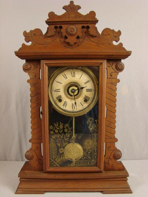 "17: Seth Thomas walnut kitchen clock, 23 1/2""h"