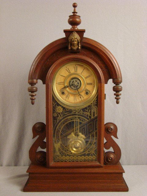 18: Walnut kitchen clock with arched top and finial, 24