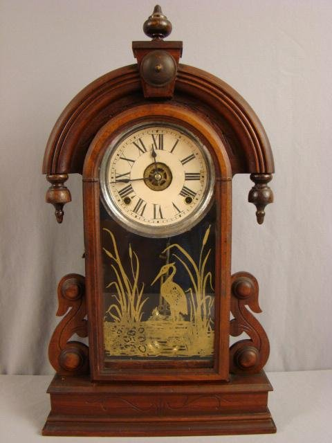 19: Walnut kitchen clock with arched top and finial