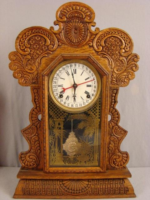 21: Ingraham oak gingerbread kitchen clock, nice carvin