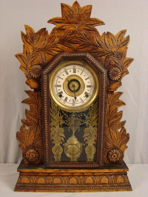 22: Gilbert No. 3 oak gingerbread kitchenclock, 23 1/2""