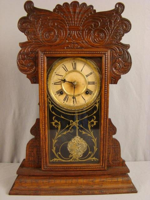 23: Waterbury oak gingerbread kitchen clock, 22""