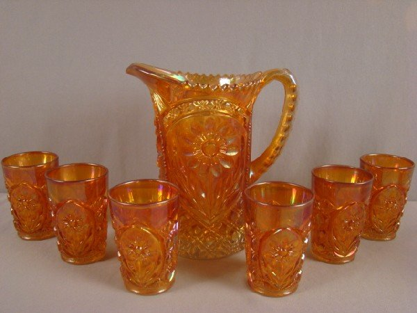 1020: Imperial marigold carnival glass pitcher and 6 tu