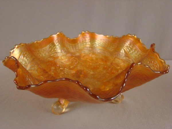 1025: Marigold carnival glass waterlilly flower and rib