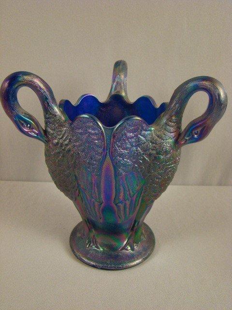 1033: Imperial blue carnival glass 3 handle swan vase,