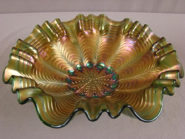 1047: Fenton green carnival glass peacock tail bowl, 9""