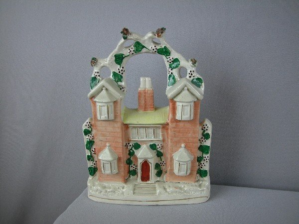 "22:  Staffordshire house figure,  11"", factory firing l"
