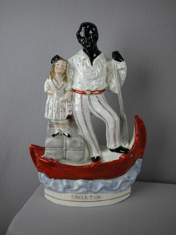 """86:  Staffordshire figure of   """"Uncle Tom"""" with Eva in"""