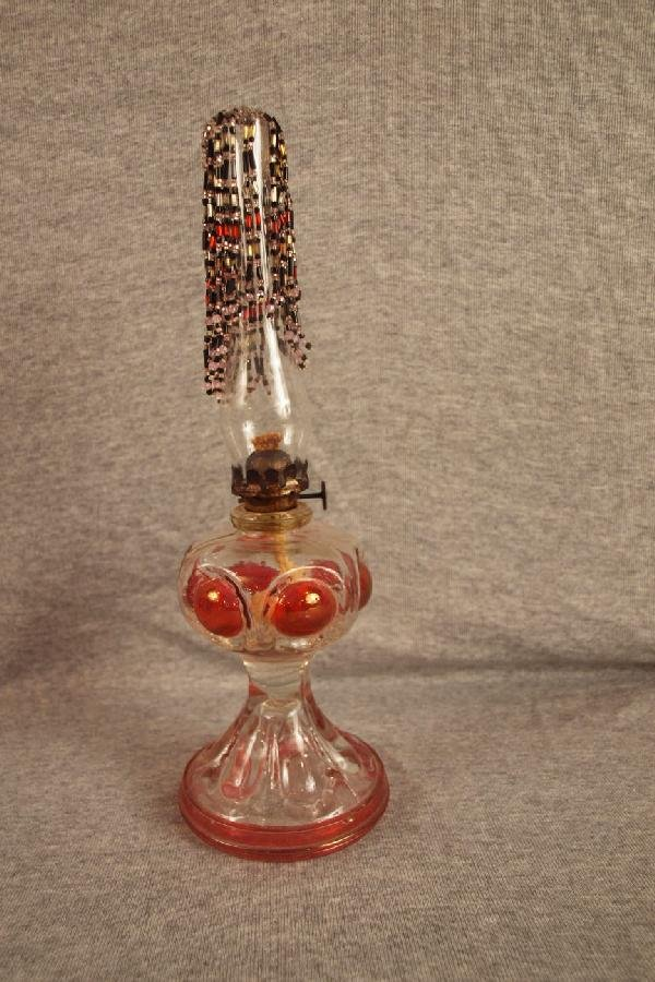 10: Ruby flash miniature oil lamp