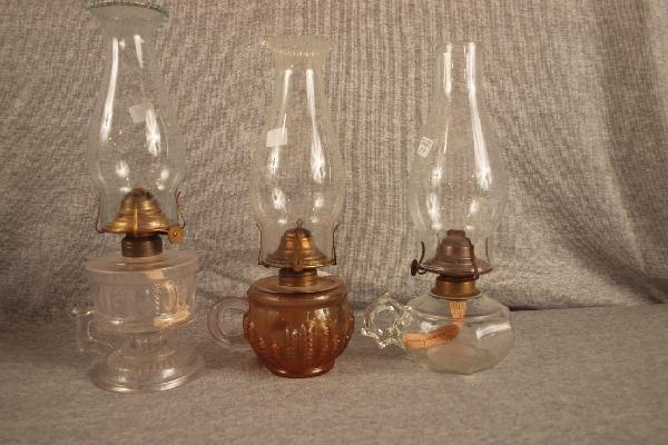 11: Lot of 3 finger oil lamps