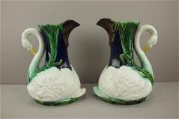 837 Pair of English majolica cobalt figural pitcher wi