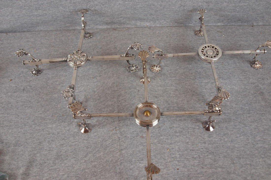20:  Lot of 3 silver trivet stands, adjustable, some wi