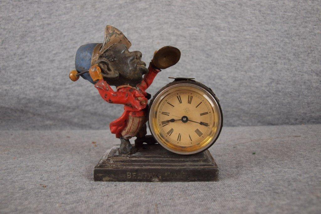 94:  Black Americana figural Ansonia clock with Black m