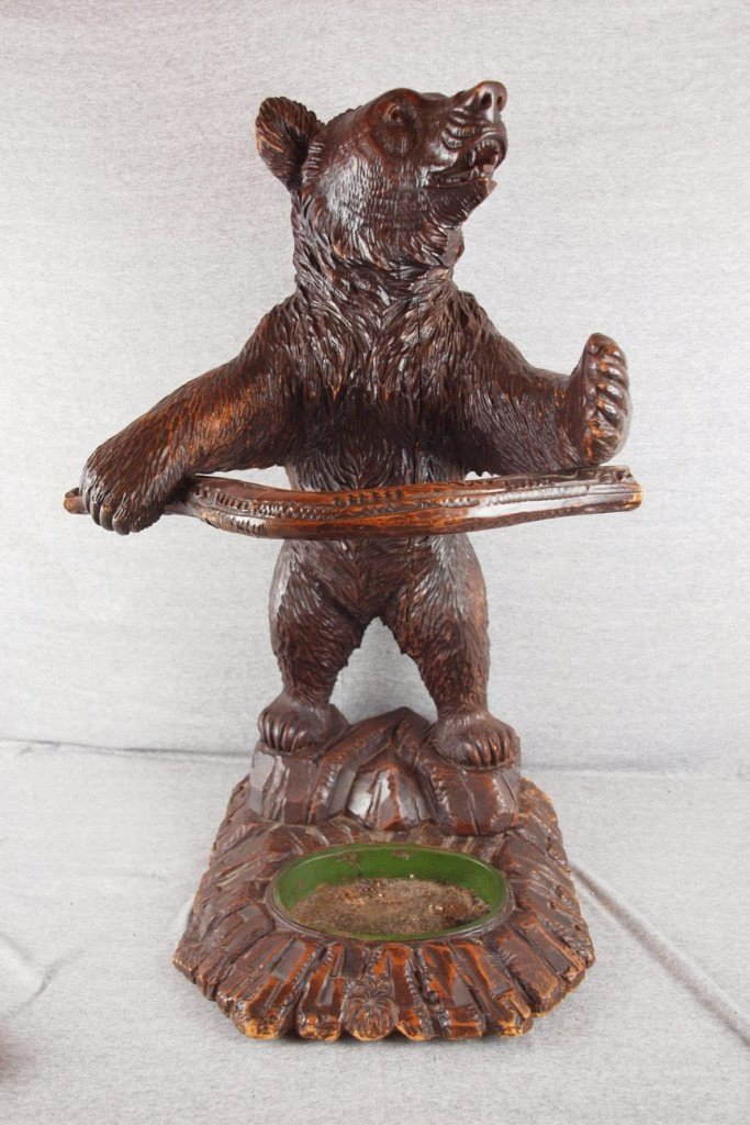 281:  Black Forest carved wooden umbrella stand in the