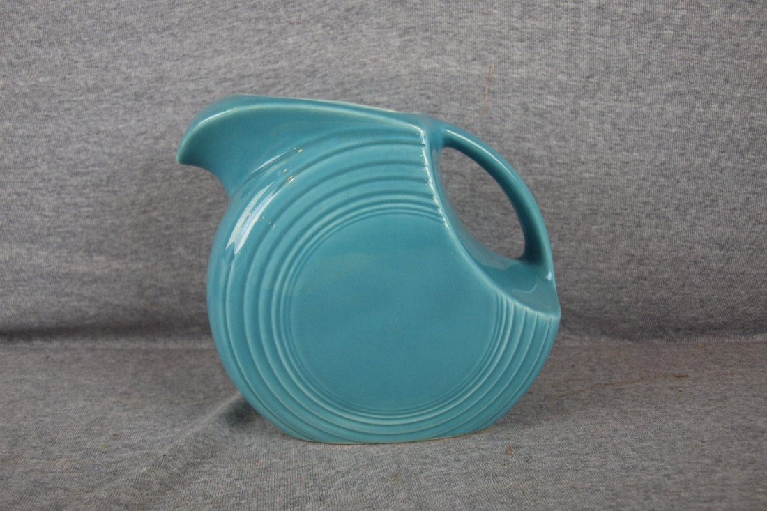 62: Fiesta turquoise disk water pitcher