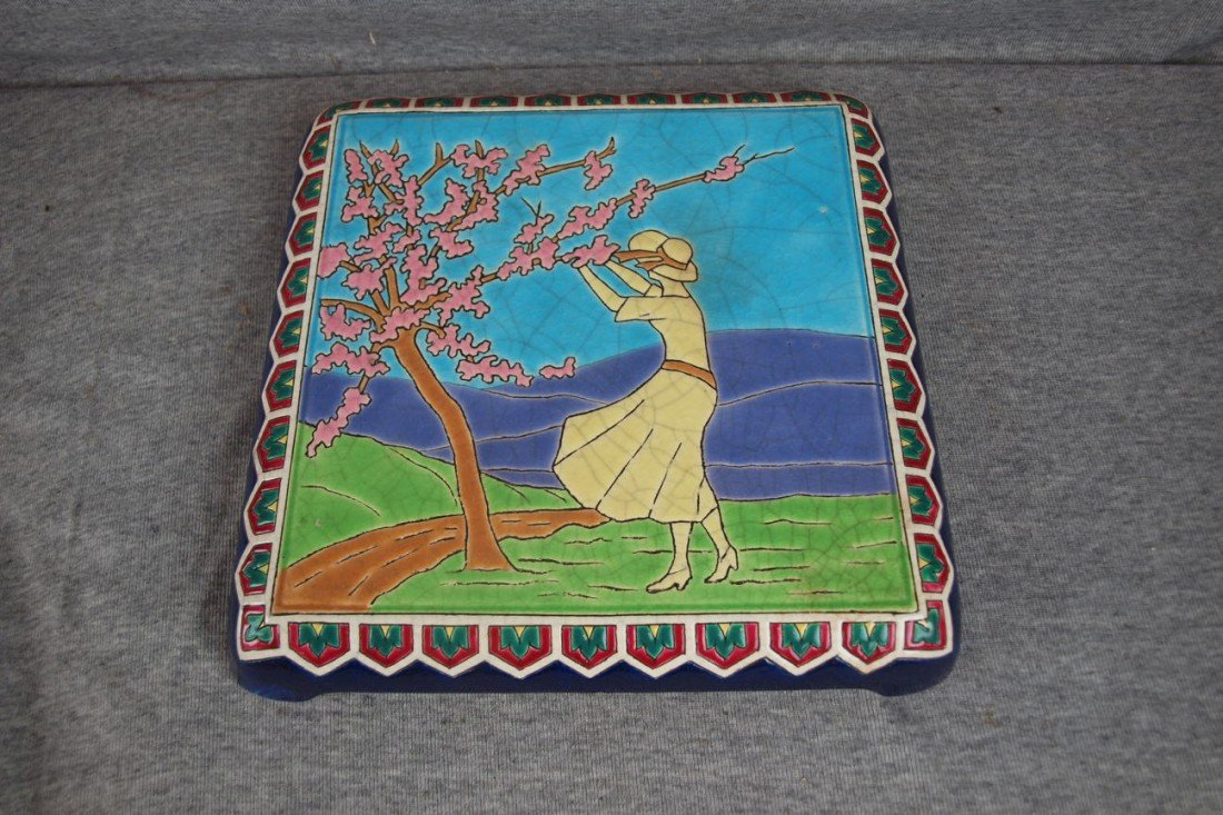 100: Longwy rare French pottery trivet stand with lady