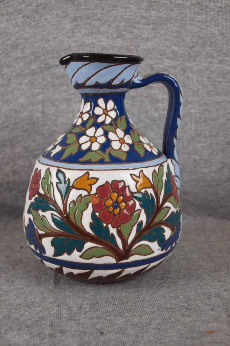 104: Spanish Pottery ewer with floral motif signed Coin