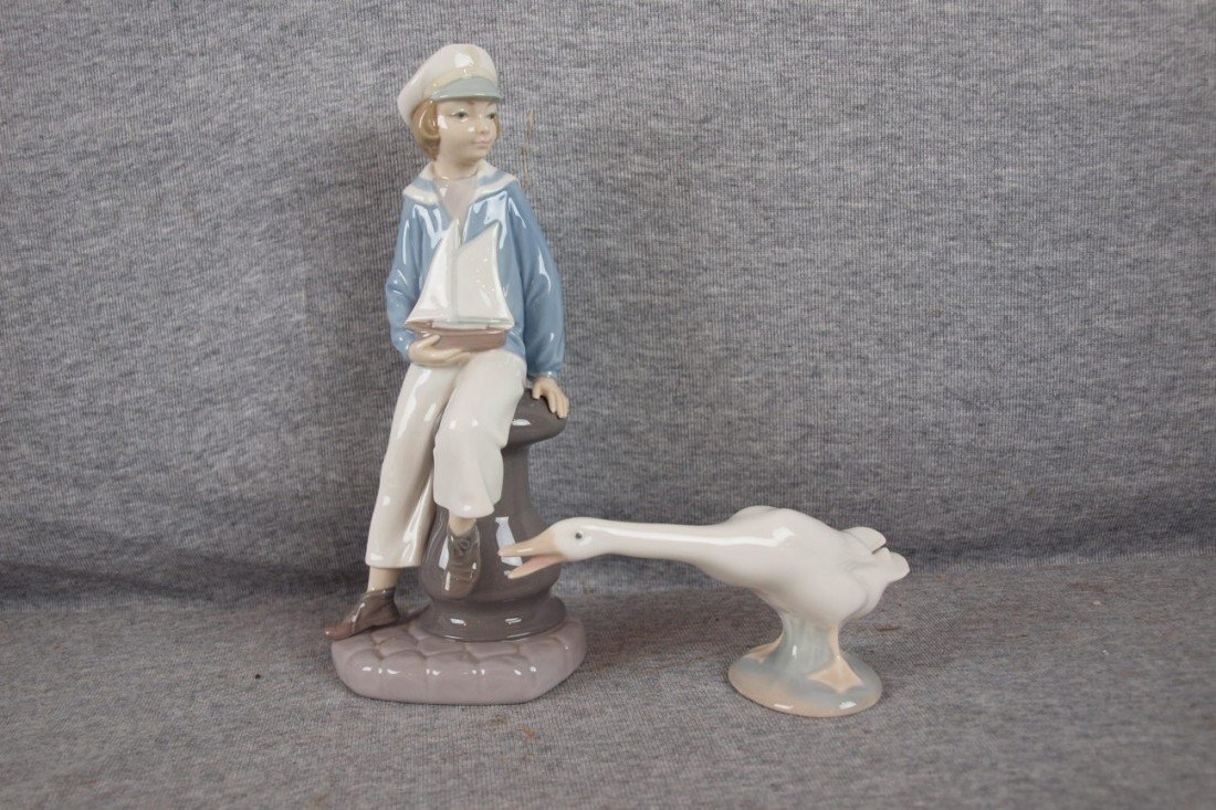 118: Lladro figure of sailor boy with pond boat AND goo