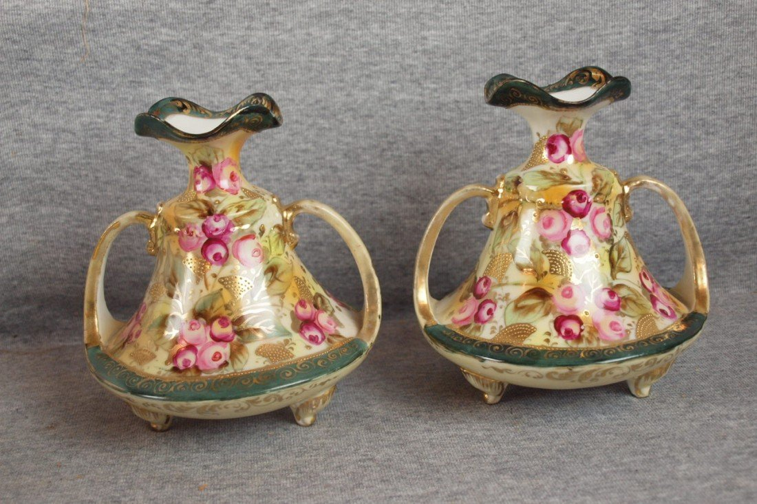 220: Nippon pair of two handled vases with floral motif