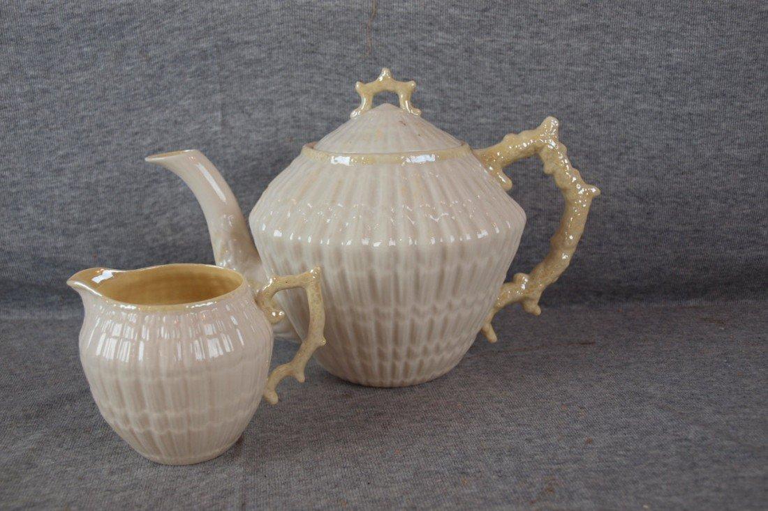 240: Belleek teapot and creamer