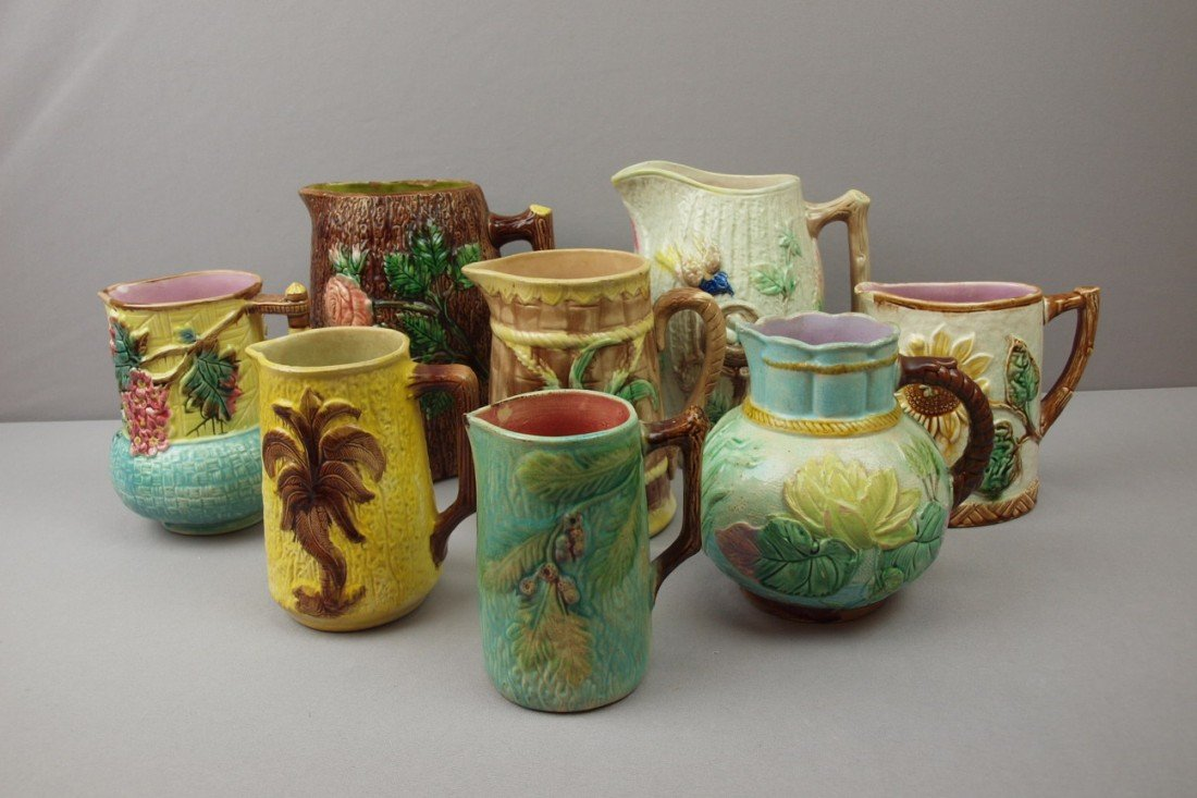4:  Majolica lot of 8 pitchers, various condition