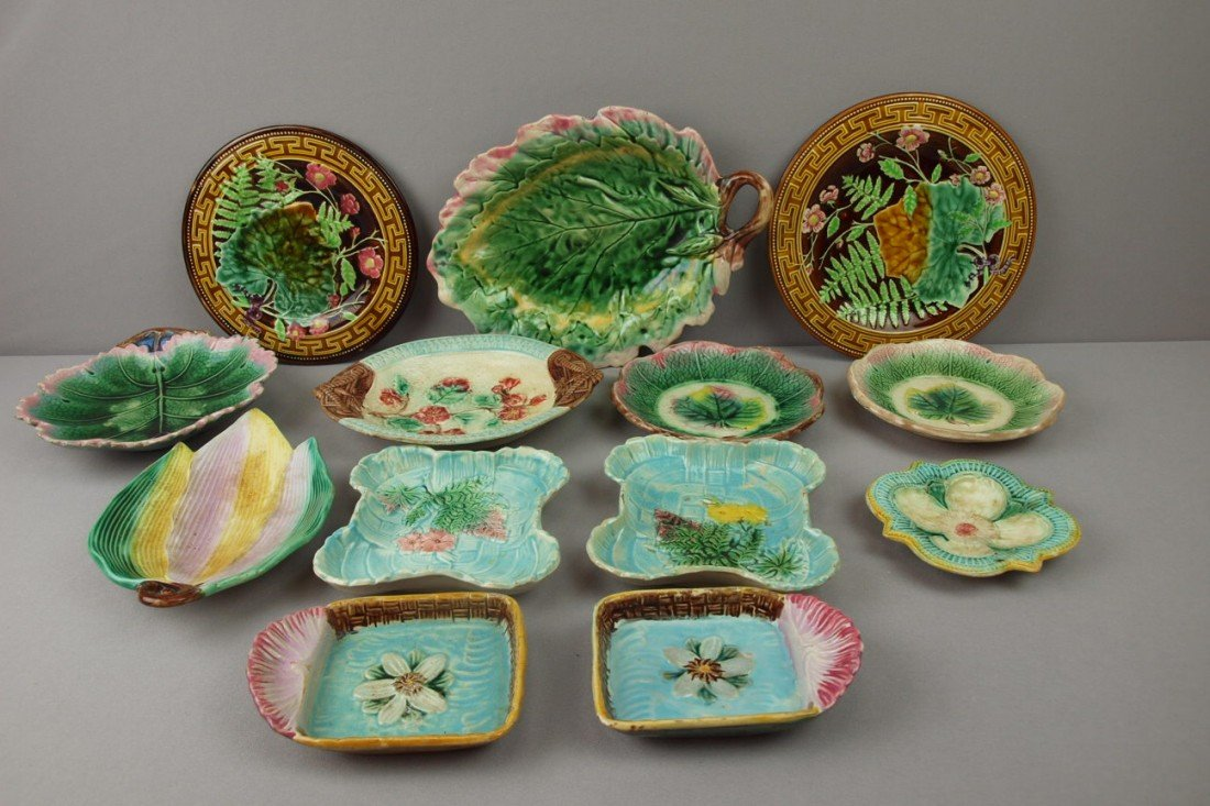 7:  Majolica lot of 13 trays and plates, various condit