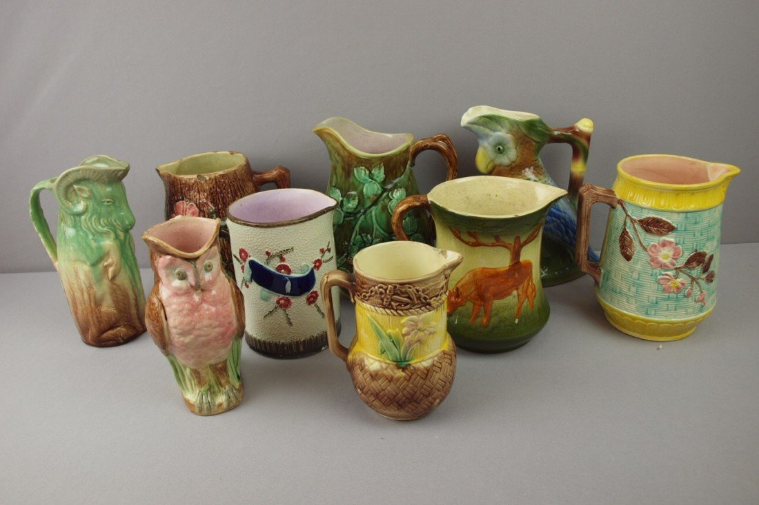 8:  Majolica lot of 10 pitchers, various condition