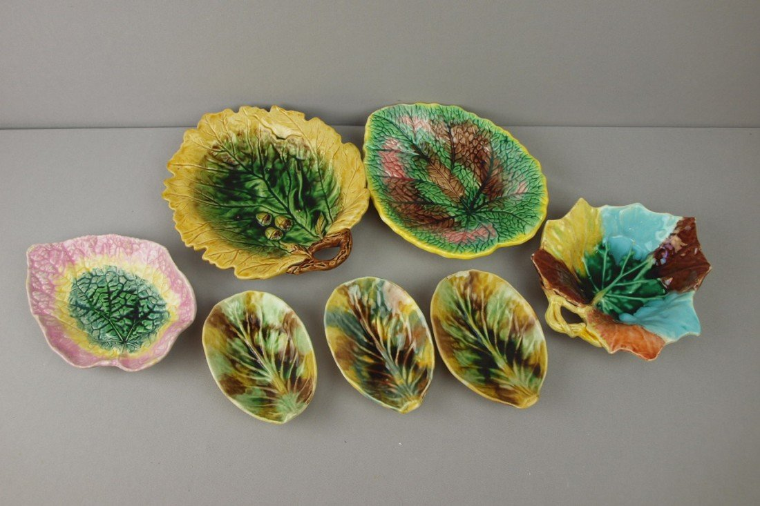 18:  Majolica lot of 7 leaf dishes, various condition