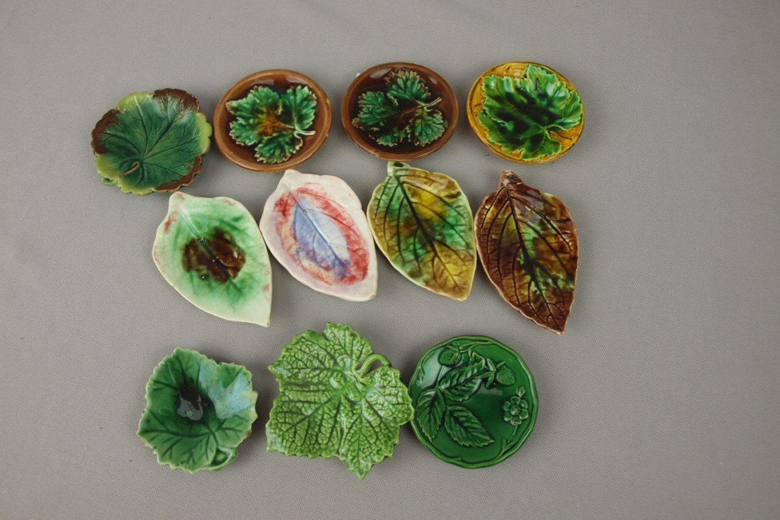 20:  Majolica lot of 11 butter pats, various condition